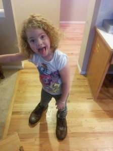 My niece Lily's cuteness continues to flourish. Here she is in her dad's size 15 shoes.